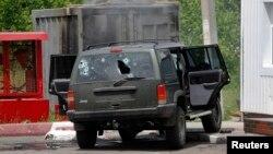 Обстріляне авто після бою біля Карлівки, 23 травня 2014 року