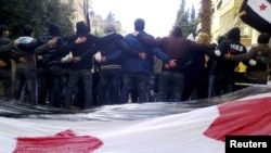 Antigovernment demonstrators protest in the city of Homs on January 9.