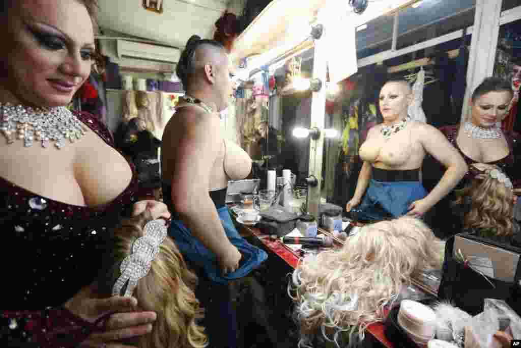 "Dancers change costumes during a break in their show at the gay nightclub ""Mayak"" on September 23."