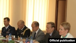 Armenia - Deputy Assistant Secretary of Defense Celeste Wallander (R) and other U.S. officials meet with Armenian Defense Minister Seyran Ohanian, 27Jun2011.