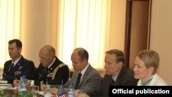 Armenia - Deputy Assistant Secretary of Defense Celeste Wallander (R) and other U.S. officials meet with Armenian Defense Minister Seyran Ohanian, 27Jun2011.