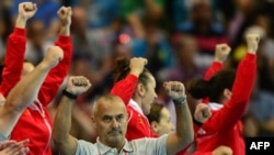U.K. - Croatia's coach Vladimir Canjuga celebrates their victory over Montenegro at the end of the women's preliminary Group A handball match Croatia vs Montenegro for the London 2012 Olympics Games, 03Aug2012
