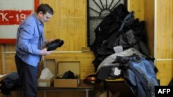 Russia -- A police officer gets a fresh set of his uniform at a store in Moscow, 24Feb2011