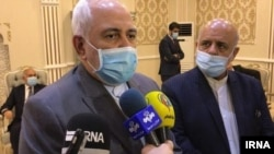 Iranian Foreign minister Mohammad Javad Zarif speaks to the media in Baghdad on July 19.
