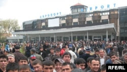 Tajikistan - Tens of passengers waiting to fly to Russia in Dushanbe airport at 29Mar2010