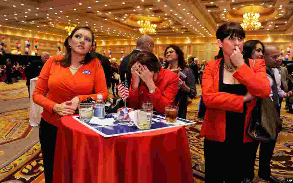 Romney supporters react to news of Obama's victory at an election-night party in Las Vegas, Nevada.