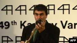 Georgian film director Giorgi Ovashvili poses with the Grand Prix Crystal Globe Award for best film, ''Corn Island,'' during the closing ceremony of the 49th Karlovy Vary International Film Festival (KVIFF) in Karlovy Vary, Czech Republic, on July 12.