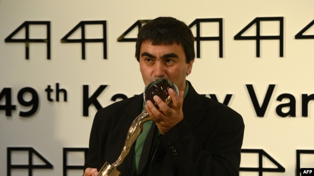 Georgian film director Giorgi Ovashvili poses with the Grand Prix Crystal Globe Award for best film,  ''Corn Island,'' during the closing ceremony of the 49th Karlovy Vary International Film Festival (KVIFF) in Karlovy Vary, Czech Republic, on July 12.