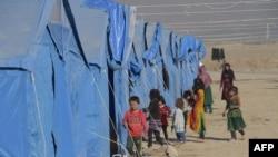 В лагере для внутренне перемещенных лиц под Кабулом. Иллюстративное фото.