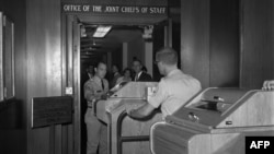 Employees install equipment for the hotline in the White House in August 1963.