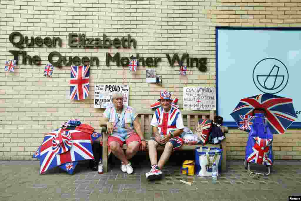 Fans of the royal family wait outside.