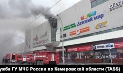 Smoke billows from the shopping center on March 25