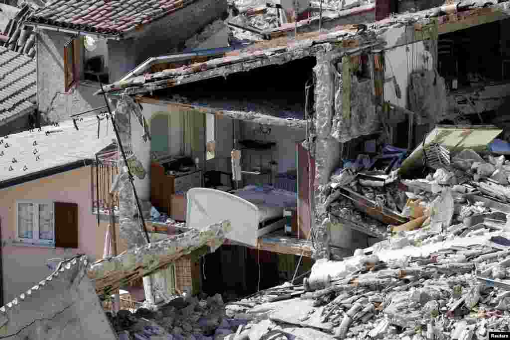 The interior of a damaged house is seen following an earthquake at Pescara del Tronto in central Italy on August 24. More than 250 people were killed in the 6.2-magnitude quake. (Reuters/Max Rossi)