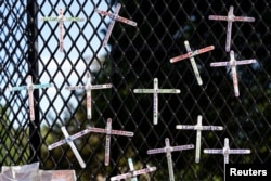 Crosses commemorating African-Americans who have died in police custody, as well as in other violent incidents, are placed on the fence surrounding the White House in Washington, D.C.