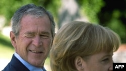 George W. Bush and Angela Merkel
