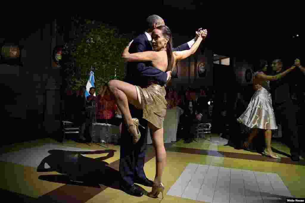 The president and first lady dance with separate tango partners during a state dinner hosted by Argentina's President Mauricio Macri in Buenos Aires on March 23, 2016.