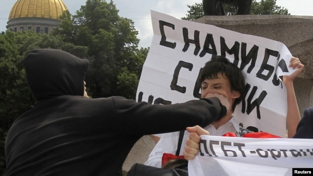 A man attacks a gay rights activist during an unsanctioned gay pride parade in St. Petersburg in June.