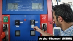 A man using his fuel card in a gas station in Tehran, on July 10, 2018. File photo
