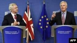 EU negotiator Michel Barnier (right) speaks as Britain's Brexit Minister David Davis listens on June 19.