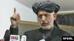 President Hamid Karzai speaks to tribal leaders in Kandahar. His recent controversial comments might be intended mainly for a domestic audience.