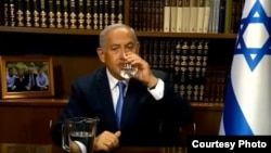 Prime Minister Benjamin Netanyahu drinks water during a video shot to introduce an Israeli initiative to counter drought by Iranian people, June 11, 2018.