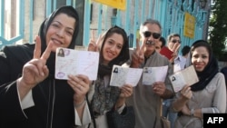 Iranians waiting to vote in Tehran on June 12.