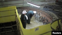 Russians work at a nuclear power plant they've helped Iran construct in Bushehr. (file photo)