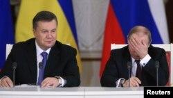 Президент Украины Виктор Янукович (слева) и президент России Владимир Путин на переговорах в Кремле. Москва, 17 декабря 2013 года.