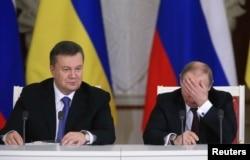 Виктор Янукович и Владимир Путин на переговорах в Москве