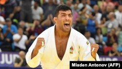 AZERBAIJAN -- Iran's Saeid Mollaei jubilates after winning in the men under 81kg category bout of the 2018 Judo World Championships in Baku, September 23, 2018