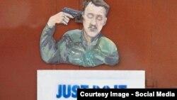 Caricatură la Donețk înfățișîndu-l pe liderul separatiștilor pro-ruși Igor Girkin (alias Strelkov)