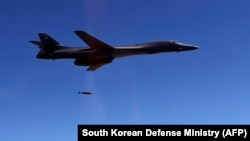 A U.S. Air Force B-1B Lancer drops a bomb at a shooting range in Gangwon Province, east of Seoul, in a drill on August 31, 2017.