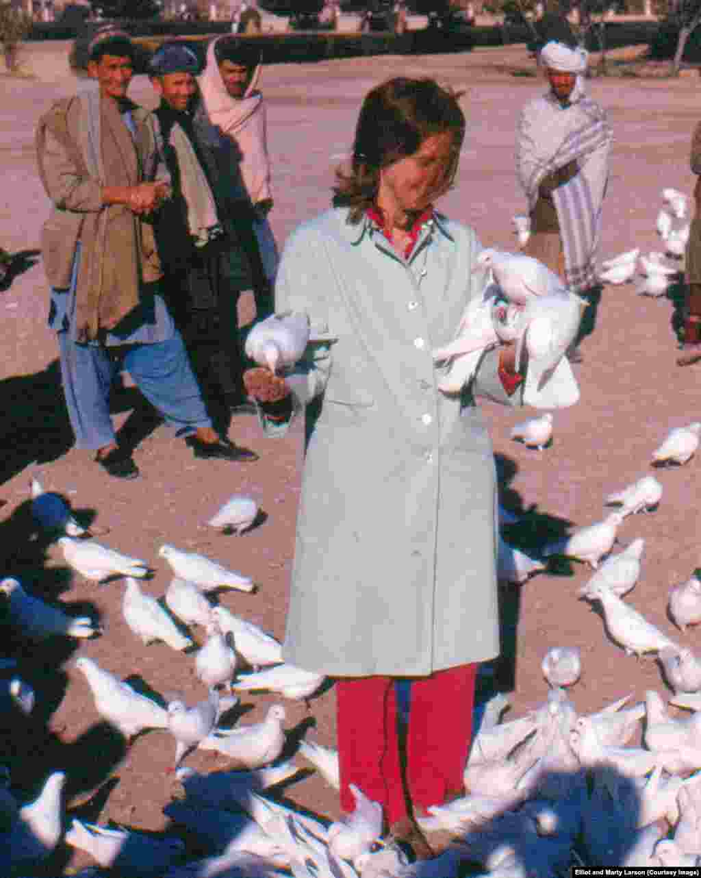 Marty Larson feeds doves at the Blue Mosque in Mazar-e Sharif.