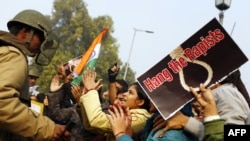 Demonstrators call for better safety for women following the rape of a student in New Delhi in December 2012.