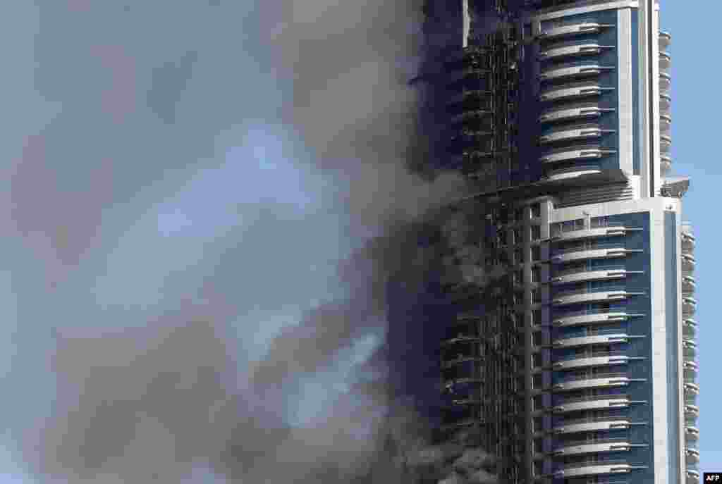 Smoke billows from the Address Downtown Hotel in Dubai on January 1, 2016, in the aftermath of a huge fire that engulfed several floors of the building. (AFP/Marwan Naamani)