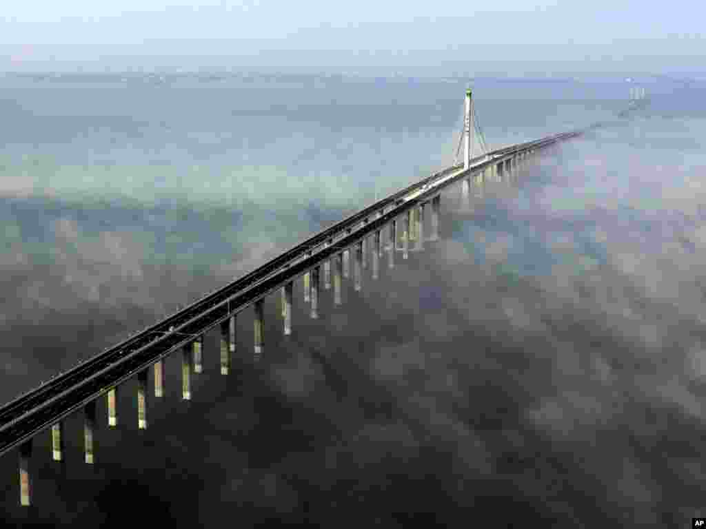 The Jiaozhou Bay Bridge in Qingdao, eastern China, opened on June 30. At 42 kilometers, it is the world's longest cross-sea bridge. Photo by Yan Runbo for AP