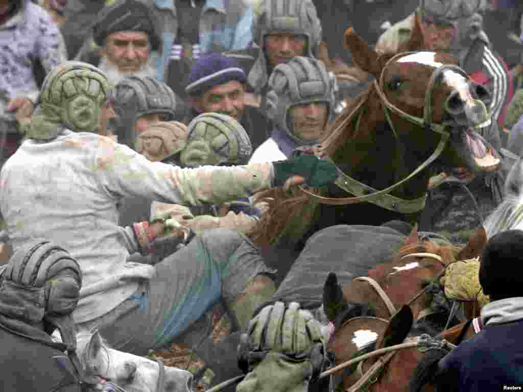 Men on horseback compete in goat dragging, a traditional Central Asian sport, outside the Tajik capital of DushanbePhoto by Nozim Kalandarov for Reuters
