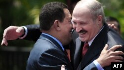 President Hugo Chavez and his Belarusian counterpart Alyaksandr Lukashenka embrace each other at the Miraflores presidential palace in Caracas.