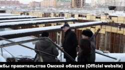 Omsk Governor Aleksandr Burkov inspects the doomed subway project in an undated photo.