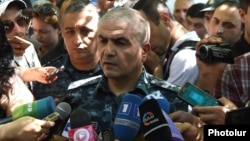 Armenia - General Hunan Poghosian, the first deputy chief of the Armenian police, speaks to reporters near a police building in Yerevan seized by anti-government gunmen, 17Jul2016.