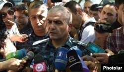 General Hunan Poghosian, the first deputy chief of the Armenian police, speaks to reporters near a police building in Yerevan seized by antigovernment gunmen.