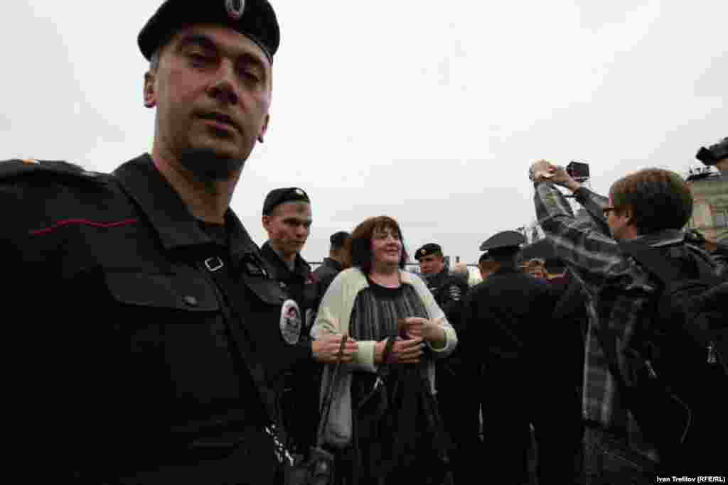 Mityushkina is led away by police.