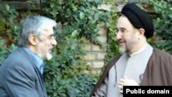 Mir Hossein Musavai (left) with with Mohammad Khatami