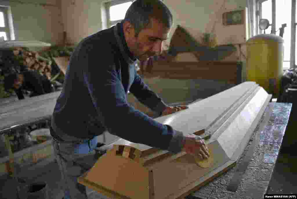 A man makes a coffin at a furniture workshop in Stepanakert on November 4. The company switched its business to casket production amid the ongoing military conflict between Armenia and Azerbaijan in Nagorno-Karabakh.