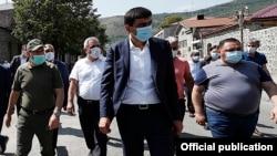 Armenia -- Armenian Prime Minister Nikol Pashinian (L), Goris Mayor Arush Arushanian (C) and other officials walk through the center of the town, September 12, 2020.