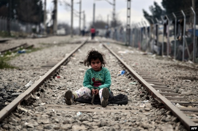 A child plays on a rail track at the Greek-Macedonian border near the Greek village of Idomeni on March 7.