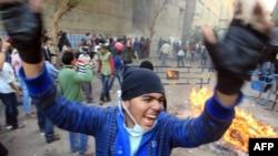 Протестующий выкрикивает лозунги. Каир, 21 ноября 2011 года.
