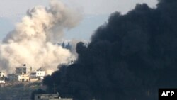 Smoke from Israeli strikes billows in Gaza City on January 9.