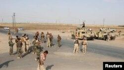 Membrii ai forțelor de securitate kurde, Kirkuk, Irak, 12 iunie 2014.