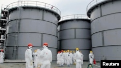 Tanks of radiation-contaminated water are seen at the tsunami-crippled Fukushima Daiichi nuclear power plant in Japan.